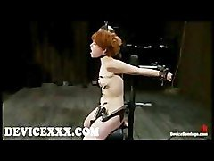 Bound in metal device Juliette on sybian gets clamped