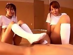 2 asian girls in socks give footjob in the gym