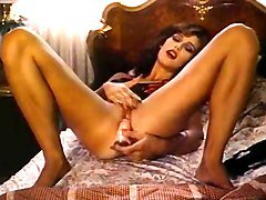 Retro classic - lady in satin lingerie pleasuring herself